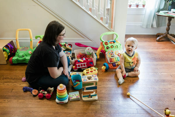 "Emma Pepper plays with her son at their home in Charleston. Pepper struggled to breastfeed for six weeks before switching to formula -- a decision she says she wishes she would have made ""much sooner."""