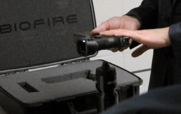 Inventor Kai Kloepfer displays his fingerprint-activated smart gun during a gun safety technology expo in Milwaukee on Jan. 16, 2019.