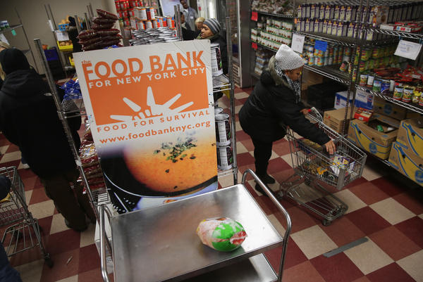 Harlem residents choose free groceries at the Food Bank For New York City in 2013. A number of new rules and actions proposed by the Trump administration could affect poor or low-income people who use government safety net programs.