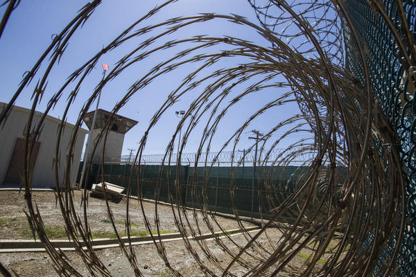 The control tower at the Camp VI detention facility in the Guantanamo Bay Naval Base, as seen through razor wire, in April.