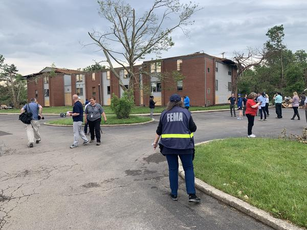 FEMA investigators assess a tornado-damaged apartment building in Trotwood.