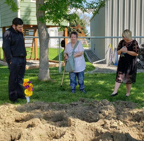 Community members attending burial