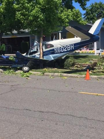 <p>Police in Medford arrested two men on drug charges after their plane crashed Saturday afternoon on a residential street.</p>