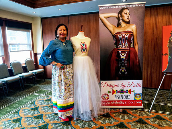 Della Bighair-Stump describes the white gown she designed, which will be part of the fashion show at Old Faithful Inn in Yellowstone National Park, June 11, 2019.
