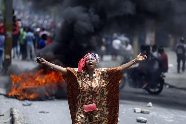 A protester yells anti-government slogans on Sunday at a demonstration in Port-au-Prince, Haiti.