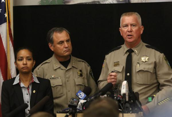 <p>In this file photo from Oct. 2, 2015, Douglas County Sheriff John Janlin, right, addresses the media at a news conference at the Roseburg Public Safety Building in Roseburg.&nbsp;</p>
