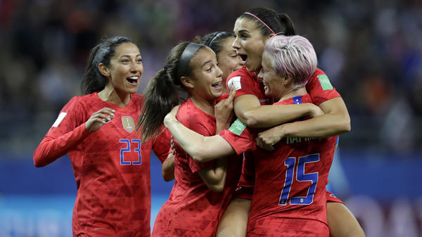Alex Morgan (second right) celebrates after scoring the United States' 12th goal during the team's 13-0 win over Thailand Tuesday.