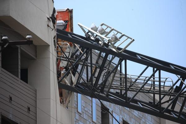 Officials respond to the scene after a crane collapsed into Elan City Lights apartments in Dallas amid severe thunderstorms on Sunday. in Dallas. Storms pummeled parts of North Texas on Sunday..