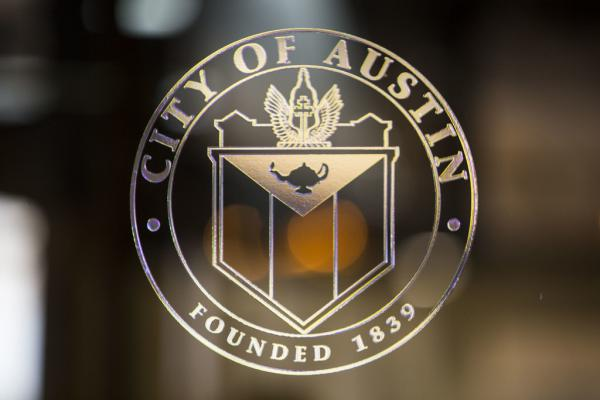 The seal of the City of Austin in Austin City Hall.