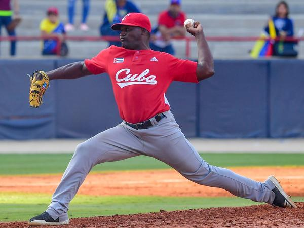 Alexis Rivero of Cuba's Los Leñeros de Las Tunas pitches during a Caribbean Series match against Venezuela's Cardenales de Lara in Panama City on Feb. 6. Major League Baseball had made a deal with Cuba's baseball federation to allow Cuban athletes to play in the U.S. without defecting, only to see the Trump administration subsequently block the rule.