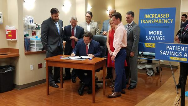 DeSantis signs the Patient Savings Act in Jacksonville, Florida