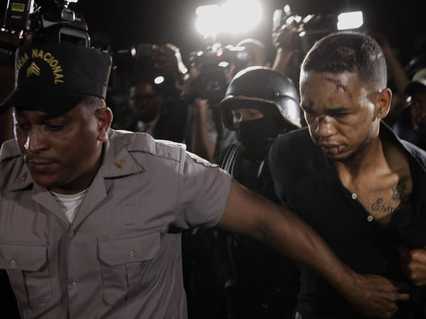 Eddy Vladimir Feliz Garcia, the alleged getaway driver in the shooting of ex-Boston Red Sox slugger David Ortiz, is escorted to court in Santo Domingo, Dominican Republic.
