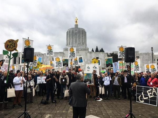 <p>Hundreds of people protest in favor of cap-and-trade legislation at the Oregon Capitol in Salem, Oregon, Wednesday, Feb. 6, 2019. The bill&nbsp;aims to limit carbon emissions.</p>