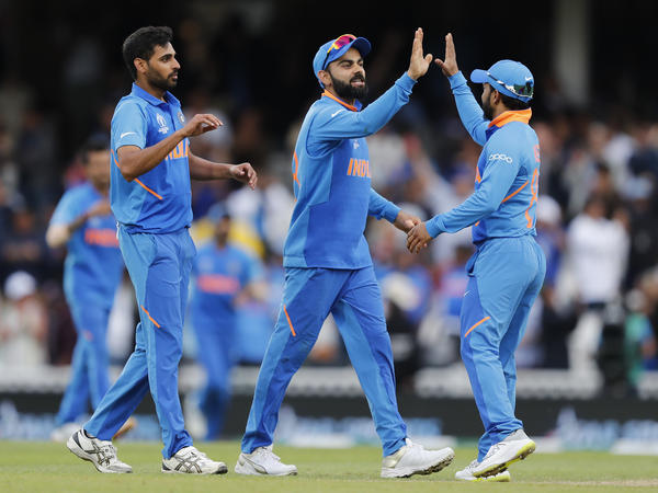 India teammates celebrate after winning the Cricket World Cup match between India and Australia at the Oval in London on June 9. The team will face Pakistan this Sunday.