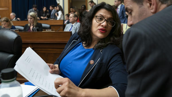 Rep. Rashida Tlaib, D-Mich., pauses as the House Oversight and Reform Committee votes on Wednesday to hold Attorney General William Barr and Commerce Secretary Wilbur Ross in contempt for failing to turn over subpoenaed documents related to the Trump administration's decision to add a citizenship question to the 2020 census.