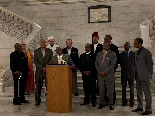 Rev. James D. Ross and other religious leaders gathered at St. Louis City Hall to demand for the firing of officers who were accused of sharing racist Facebook posts.
