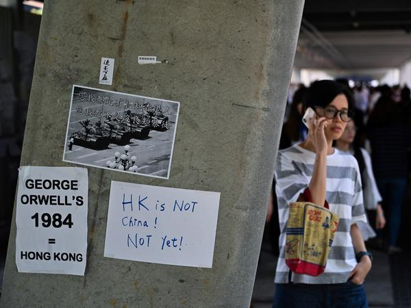Placards against a controversial extradition law proposal pasted on a wall near the Legislative Council complex in Hong Kong on Friday.