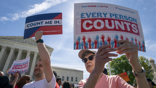 Demonstrators rally outside the Supreme Court in April as the justices hear arguments over the Trump administration's plan to add a citizenship question to 2020 census forms.