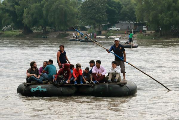 Central American migrants use a makeshift raft across the Suchiate River from Tecún Umán in Guatemala to Ciudad Hidalgo in Chiapas state, Mexico, on June 11.
