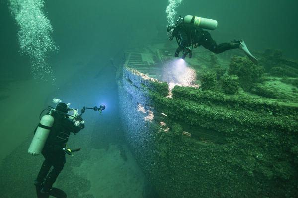 Divers explore St. Peter, an historic Great Lakes schooner that rests at the bottom of Lake Ontario off of Wayne County. Federal officials are considering designating these waters to preserve the maritime history within it.
