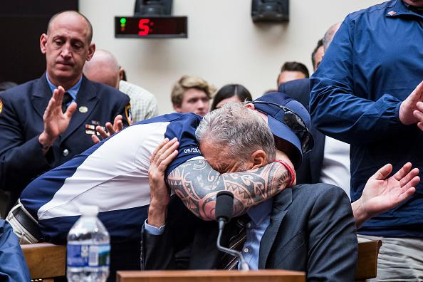 FealGood Foundation co-founder John Feal hugs former Daily Show Host Jon Stewart during a House Judiciary Committee hearing on reauthorization of the September 11th Victim Compensation Fund on Capitol Hill on June 11, 2019 in Washington, DC. The fund provides financial assistance to responders, victims and their families who require medical care related to health issues they suffered in the aftermath of 9/11 terrorist attacks.