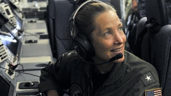 Rear Adm. Shoshana Chatfield sits at a mission crew work station in Guam. Chatfield has been named the next president of the Naval War College.