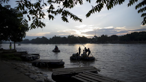 Passengers from Tecun Uman, Guatemala (across the water), arrive by raft at Ciudad Hidalgo, Mexico, on Friday at sunrise.