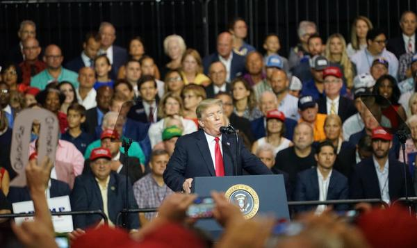 President Donald Trump speaks at the Tampa Fairgrounds during a rally July 31, 2018. A lawsuit alleging Trump kissed a former campaign staffer before a similar rally in Tampa in 2016 has been dismissed.