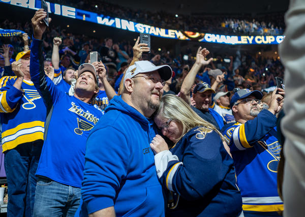 St. Louis Blues fans embrace after a long-awaited first Stanley Cup win for the franchise. They joined thousands who watched the historic win on the video board at Enterprise Center in St. Louis.
