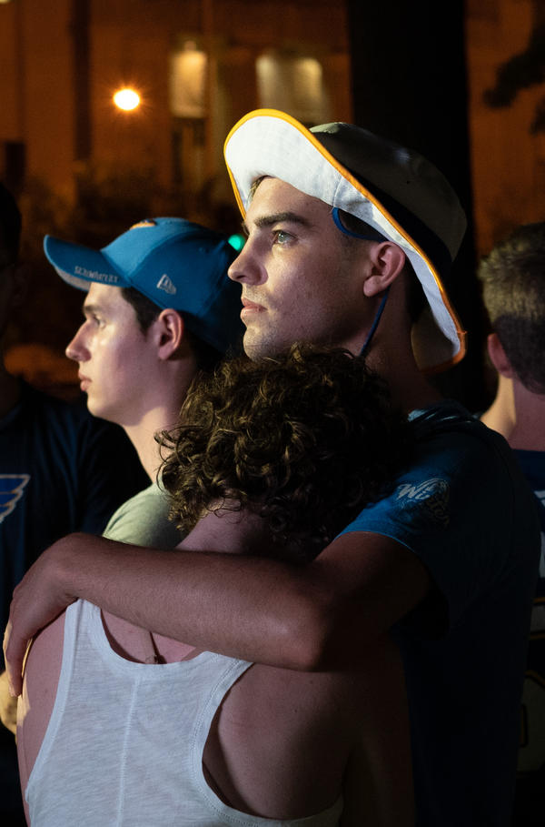 Jessica Flach, 29, of St. Louis County, and Nathan Dye, 22, of St. Louis, embrace during the final minutes of the Blues' Game 6 loss on Sunday.