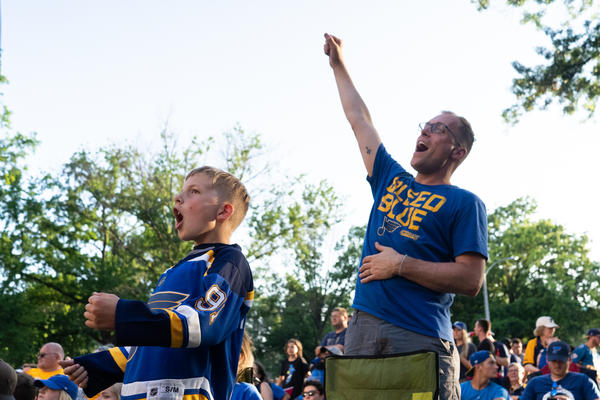 Casey Eldridge, 38, and his 9-year-old son, Carter, cheer on the Blues at the Game 6 watch party.