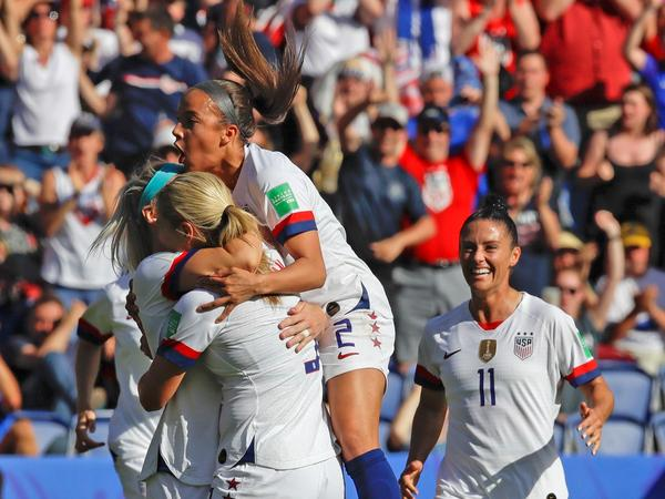 U.S. players celebrate after teammate Julie Ertz scored their side's second goal during the Women's World Cup Group F soccer match between United States and Chile at Parc des Princes in Paris, France on Sunday.