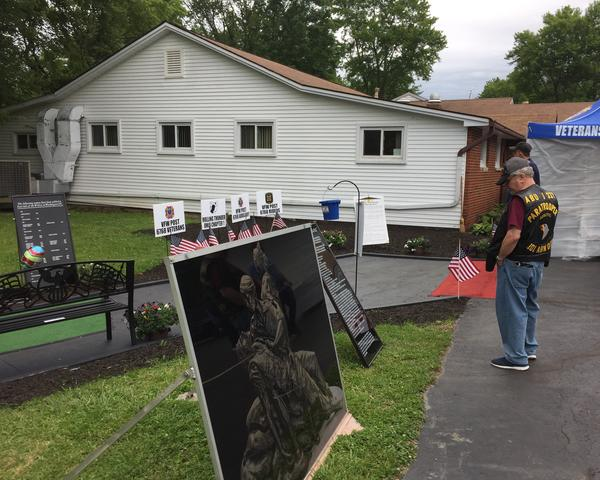 Bob Papesh (right) visited the travelling Vietnam Veterans Memorial Wall in Northfield over the weekend, and says he's felt the effects of Agent Orange. The new bill expands eligiblity for VA benefits for people who served in the Vietnam War.