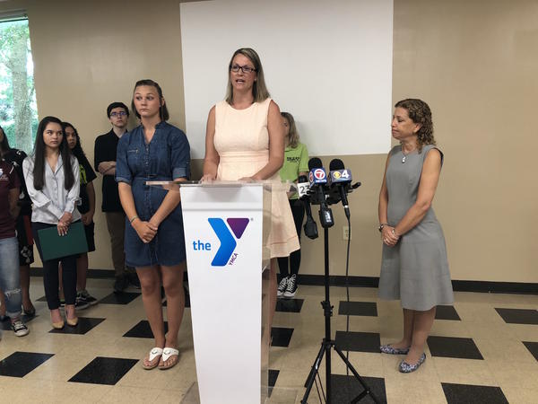 Erin Nessmith has filed a class-action lawsuit against e-cigarette companies after her 15-year-old daughter Ashlynn, left, became addicted to vaping. Congresswoman Debbie Wasserman Schultz, right, looks on during the press conference at the Weston YMCA.