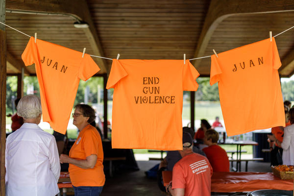 T-shirts hang up at a recent #WearOrange event hosted by Moms Demand Action for Gun Sense in America's local chapter in Normal.