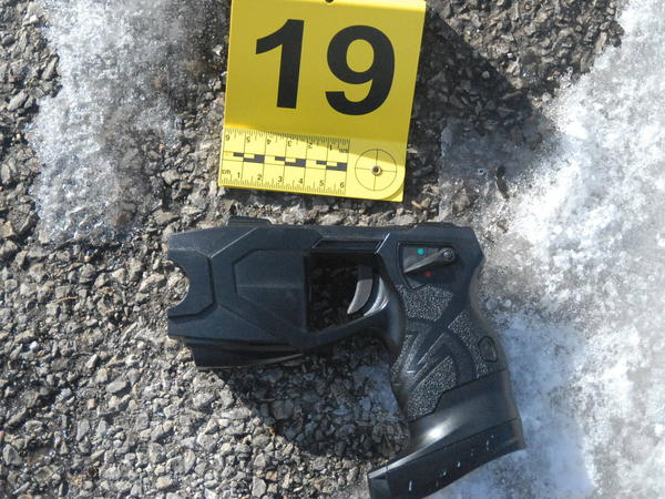 A Taser X26P lies next to a crime scene marker after a police officer in Zion, Ill., tried unsuccessfully to use it on a suspect named Charles Hollstein in 2016. Hollstein struggled with officers after two Tasers failed to subdue him. An officer shot and killed him during the struggle.