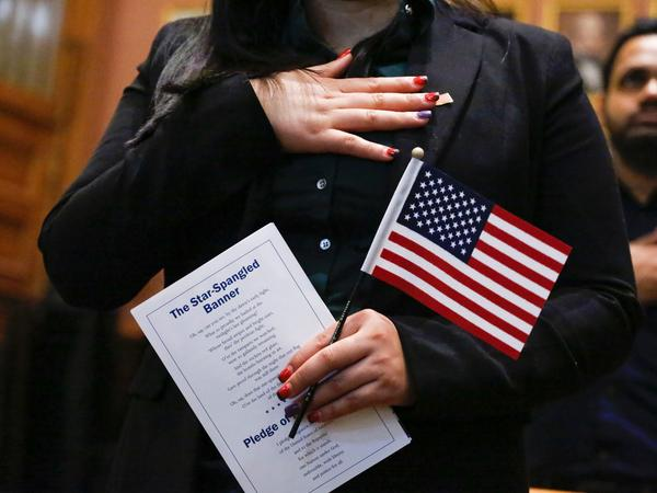 Candidates for U.S. citizenship take the oath of allegiance during a 2017 naturalization ceremony in Jersey City, N.J. A federal judge's order Wednesday could complicate the Census Bureau's plans to finalize census questionnaires and start printing paper forms for the national head count by July 1.