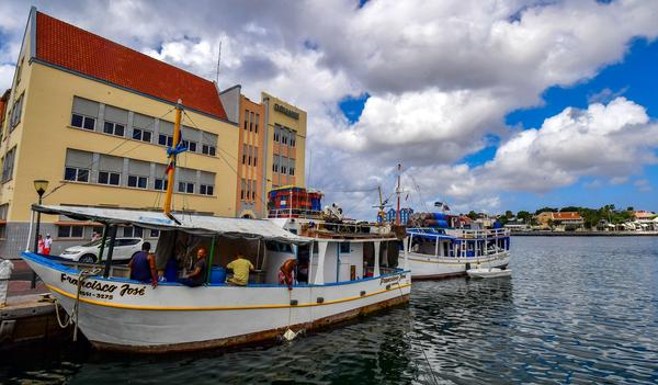Venezuelan boats are moored at a port in Willemstad, Curaçao, in February. For many Venezuelans, Caribbean islands like Curaçao are escapes from their country's turmoil.