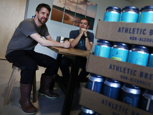 Athletic Brewing Co. co-founders Bill Shufelt (right) and John Walker, here at the company's production plant in Stratford, Conn., have created a range of high-quality nonalcoholic beers to provide people more options when they're out socializing.