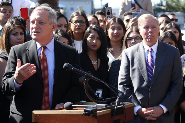Sen. Dick Durbin, D-Ill., left and Sen. Lindsey Graham, R-S.C. at a news conference with recipients of the Deferred Action for Childhood Arrival program (DACA) during a 2017 news conference.