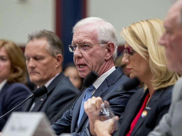 """Capt. Chesley """"Sully"""" Sullenberger, accompanied by other pilots and former FAA administrator Randy Babbitt, speaks during a House Committee on Transportation and Infrastructure hearing on the status of the Boeing 737 Max in Washington, D.C."""