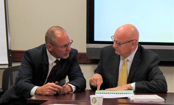 Kansas universities offered more modest tuition proposals after the Board of Regents scoffed at increases last month. Vice Chair Shane Bangerter (left) and Chair Dennis Mullin pored over documents before the meeting Wednesday.