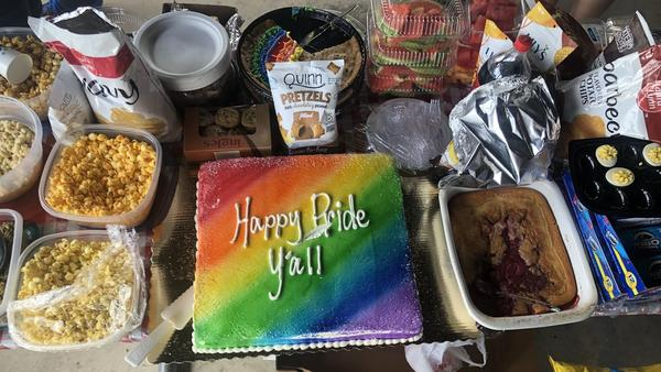 """Attendees brought a range of picnic fare to the Hendersonville Pride potluck, including a strawberry cobbler, deviled eggs, watermelon and a rainbow cake that reads """"Happy Pride Y'all."""""""