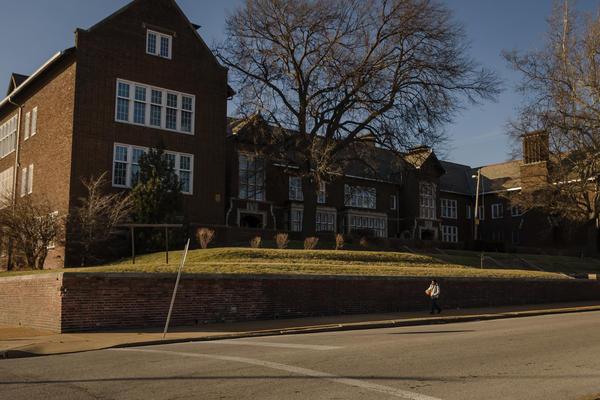 A student leaves Dunbar Elementary School in the JeffVanderLou neighborhood Jan. 9, 2019.