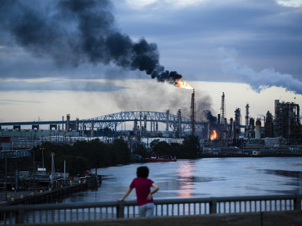 Flames and smoke rise from the Philadelphia Energy Solutions refining complex on Friday morning. Officials said the fire had been confined but was not yet under control.