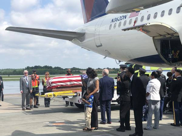Relatives and friends wait as the body of  Private First Class William H. Jones is lowered from an airplane at RDU on Thursday, June 20, 2019.