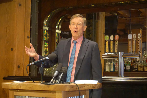 Former Colorado Gov. John Hickenlooper talks to reporters about his presidential campaign at the Wynkoop Brewing Co. in downtown Denver.
