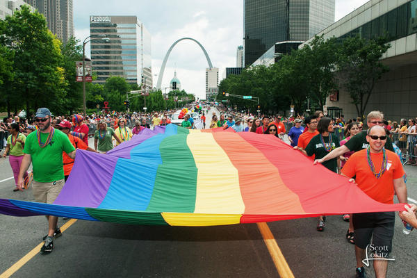 Revelers march down Market Street in this file photo from a previous Pride Parade.