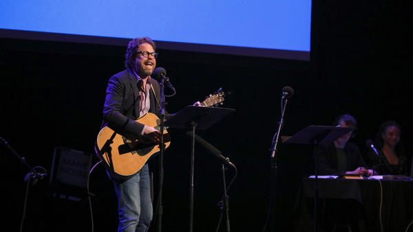 <em>Ask Me Another</em>'s house musician Jonathan Coulton performs at the Moore Theatre, in Seattle, Washington.