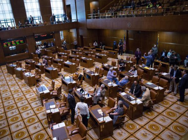 <p>Democratic members of the Oregon Senate stand in the mostly empty Senate chambers at the Oregon Capitol in Salem, Ore., on Thursday, June 27, 2019. On the eighth day of a walkout by Republican senators, Oregon Senate President Peter Courtney adjourned the session shortly after it began due lacking the required number of senators to meet a quorum.</p>